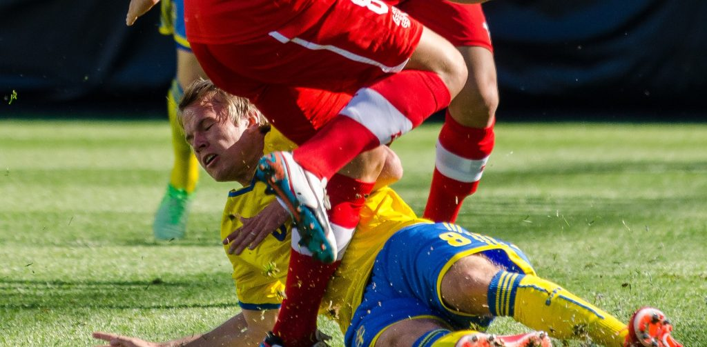 Oscar Lewicki of Sweden in a tackle